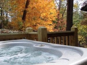 Bubbling hot tub with a scenic autumn view at a two bedroom cabin in Murphy NC