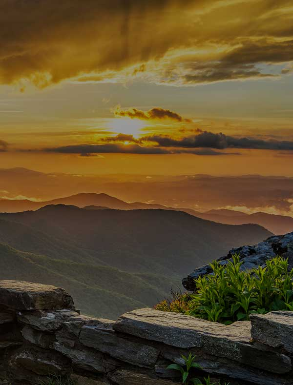 An incredible photo of the sun setting in the mountains in North Carolina.