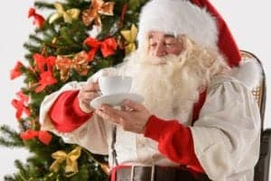 Santa drinking hot cocoa.