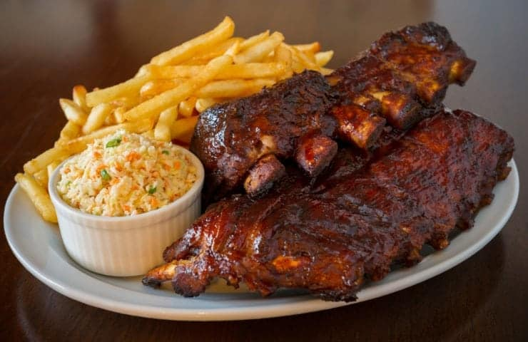 barbecue ribs with coleslaw and fries