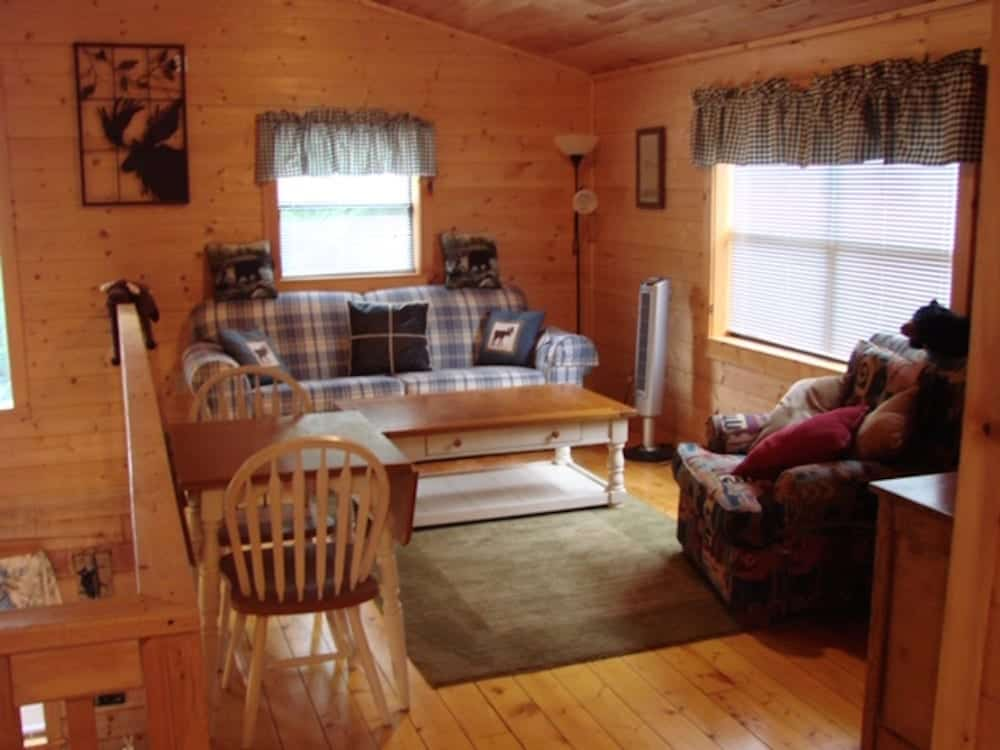 sitting area upstairs in a cabin with wood paneling